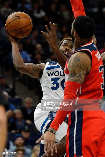 Aaron Brooks of the Minnesota Timberwolves shoots the ball against Mike Scott of the Washington Wizards during the game on November 28 2017 at the...