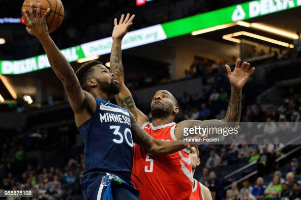 Aaron Brooks of the Minnesota Timberwolves shoots the ball against Aaron Jackson of the Houston Rockets in Game Four of Round One of the 2018 NBA...