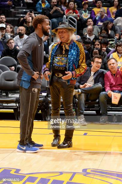 Aaron Brooks of the Minnesota Timberwolves talks with Jimmy Goldstein during the game between the Minnesota Timberwolves and Los Angeles Lakers on...