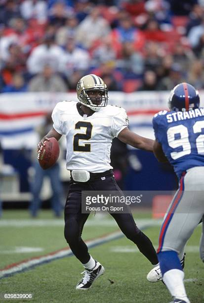 Aaron Brooks of the New Orleans Saints drops back to pass against the New York Giants during an NFL football game on September 30 2001 at Giants...
