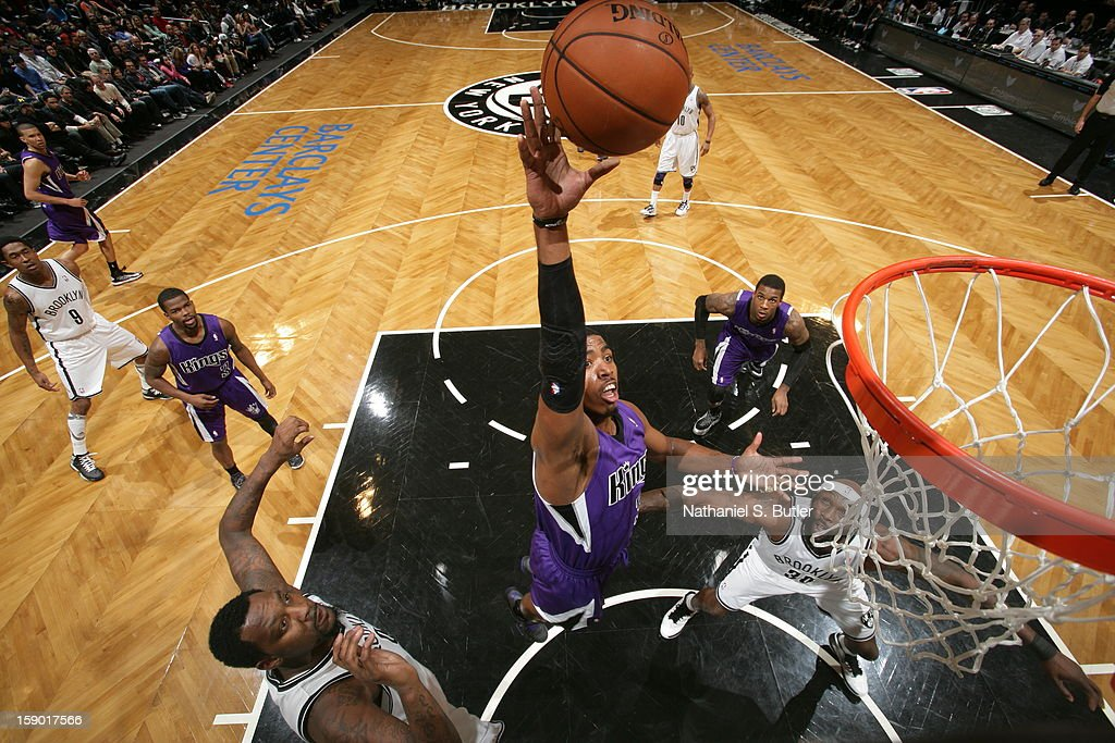 Aaron Brooks #3 of the Sacramento Kings shoots against Andray Blatche #0 and Reggie Evans #30 of the Brooklyn Nets on January 5, 2013 at the Barclays Center in the Brooklyn borough of New York City.