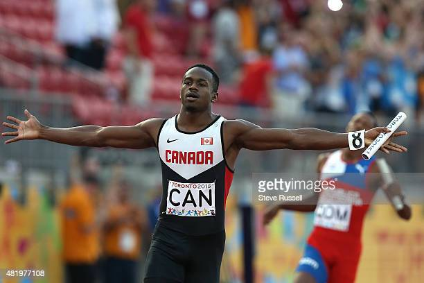 TORONTO ON JULY 25 Aaron Brown crosses the finish line for Canada as Canada wins the men's 4x100 metre relay at Pan Am Track and Field at CIBC...