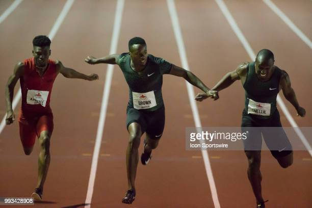 Aaron Brown lunges at the line to narrowly win the 100m with a time of 1016 ahead of Gavin Smellie in 1023 and Mobolade Ajomale in 1022 at the 2018...