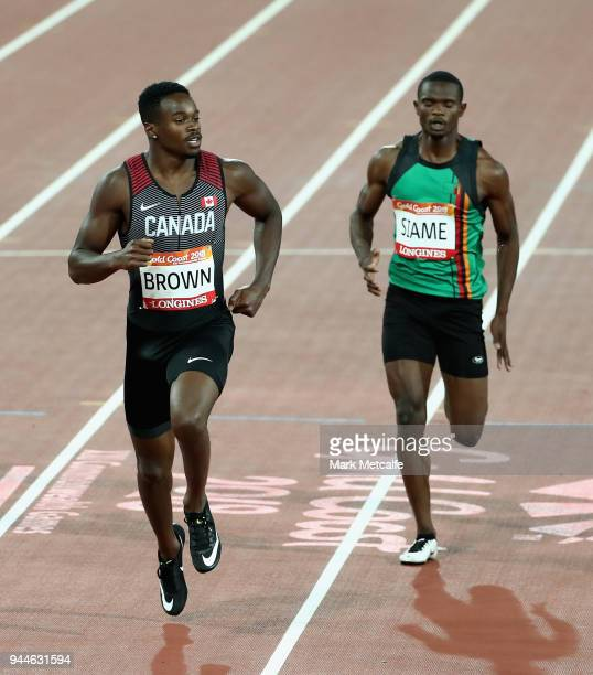 Aaron Brown of Canada and Sydney Siame of Zambia compete in the Men's 200 metres semi finals during athletics on day seven of the Gold Coast 2018...