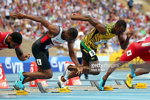 Aaron Brown of Canada and Usain Bolt of Jamaica leaves the blocks in the Men's 100 metres semi final during Day Two of the 14th IAAF World Athletics...