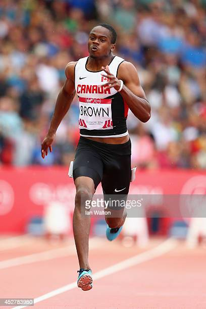 Aaron Brown of Canada competes in the Men's 100 metres heats at Hampden Park Stadium during day four of the Glasgow 2014 Commonwealth Games on July...