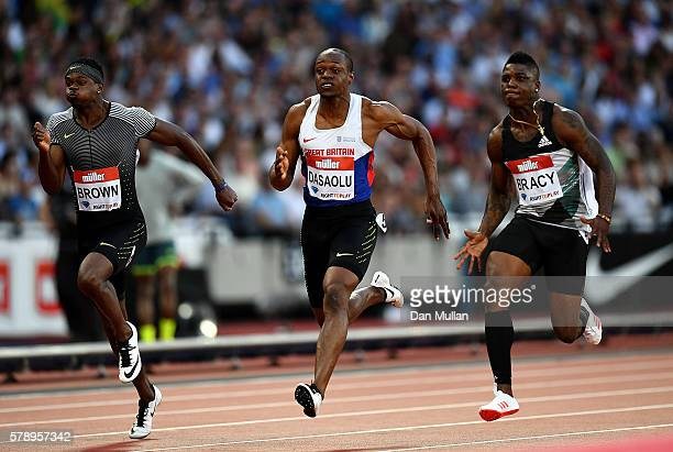 Aaron Brown of Canada James Dasaolu of Great Britain and Marvin Bracey of The USA in action during their 100m heat on Day One of the Muller...