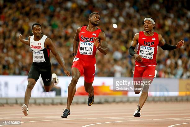 Aaron Brown of Canada Justin Gatlin of the United States and Mike Rodgers of the United States cross the finish line in the Men's 100 metres...
