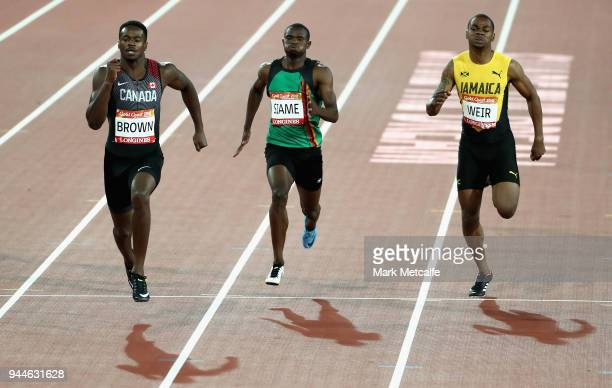 Aaron Brown of Canada Sydney Siame of Zambia and Warren Weir of Jamaica compete in the Men's 200 metres semi finals during athletics on day seven of...
