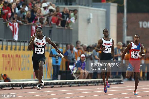 TORONTO ON JULY 25 Aaron Brown takes the hand off from Brendon Rodney the men's 4x 100 metre relay team would finish first but be disqualified at Pan...