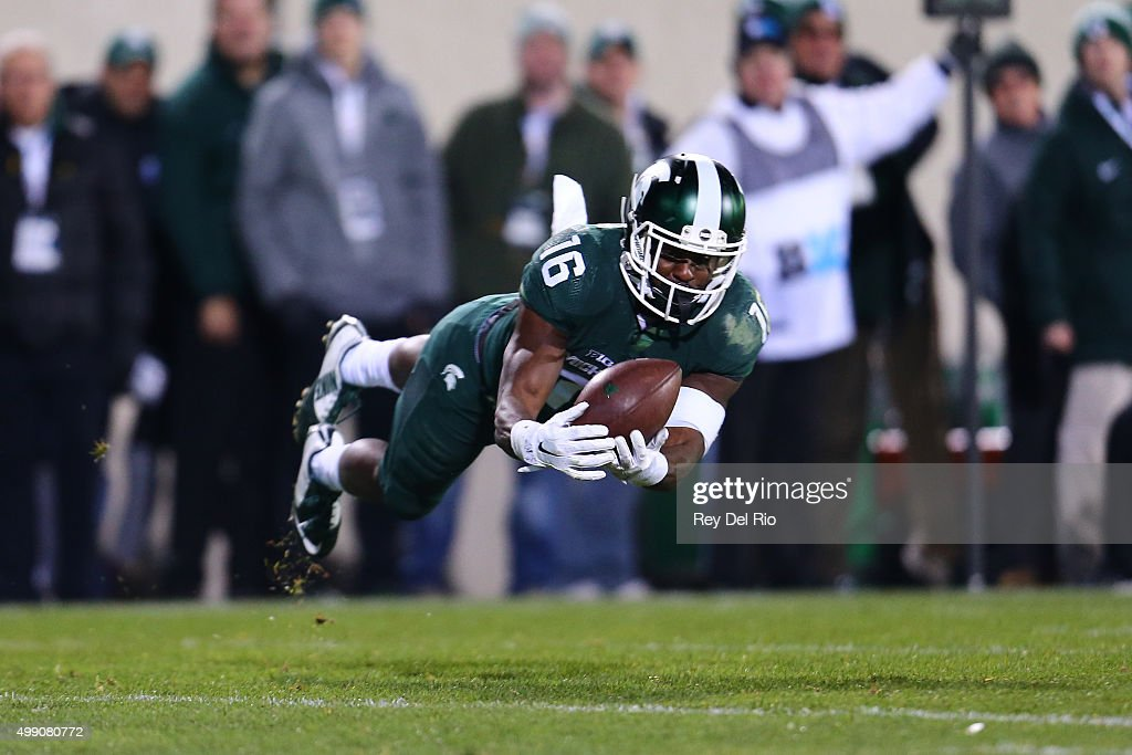 Aaron Burbridge #16 of the Michigan State Spartans attempts to make a catch in the fourth quarter against the Penn State Nittany Lions at Spartan Stadium on November 28, 2015 in East Lansing, Michigan.
