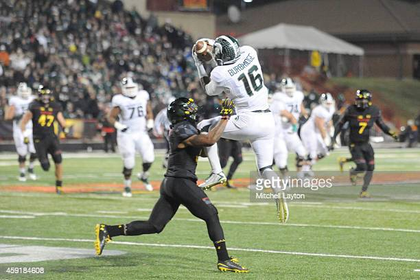 Aaron Burbridge of the Michigan State Spartans catches a pass with pressure from William Likely of the Maryland Terrapins a college football game at...