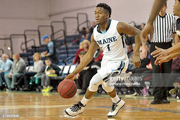 Aaron Calixte of the University of Maine drives the lane during a game vs UMBC at the Portland Expo Saturday February 6 2016