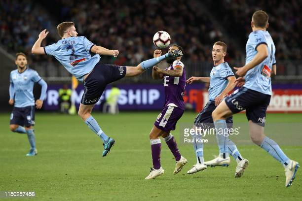 Aaron Calver of Sydney challenges Diego Castro of the Glory during the 2019 ALeague Grand Final match between the Perth Glory and Sydney FC at Optus...