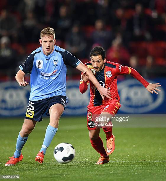 Aaron Calver of Sydney competes for the ball again Sergio Cirio of United during the FFA Cup Round of 16 match between Adelaide United and Sydney FC...