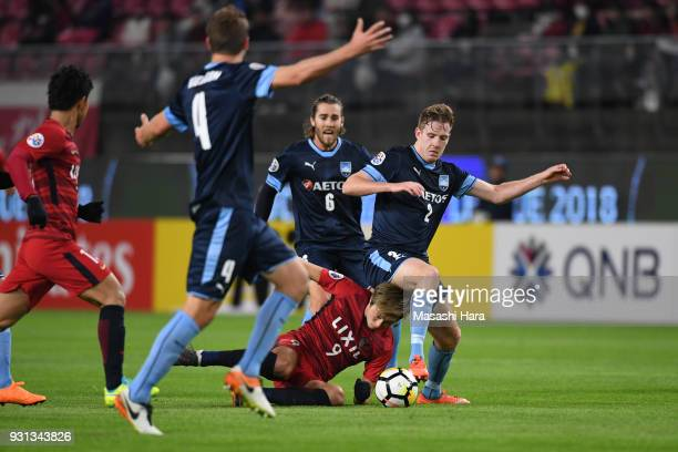 Aaron Calver of Sydney FC and Yuma Suzuki of Kashima Antlers compete for the ball during the AFC Champions League Group H match between Kashima...