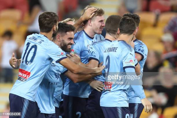 Aaron Calver of Sydney FC celebrates after scoring a goal during the round 23 ALeague match between the Brisbane Roar and Sydney FC at Suncorp...