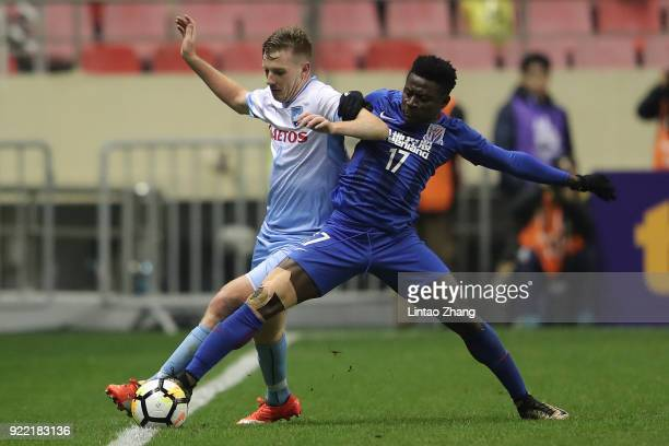 Aaron Calver of Sydney FC competes the ball with Obafemi Martins of Shanghai Shenhua FC during the AFC Champions League Group H match between...