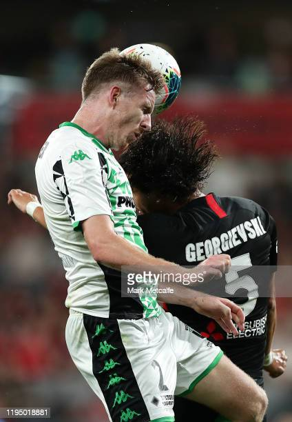 Aaron Calver of United and Daniel Georgievski of the Wanderers compete for the ball in the air during the round 11 WLeague match between the Western...