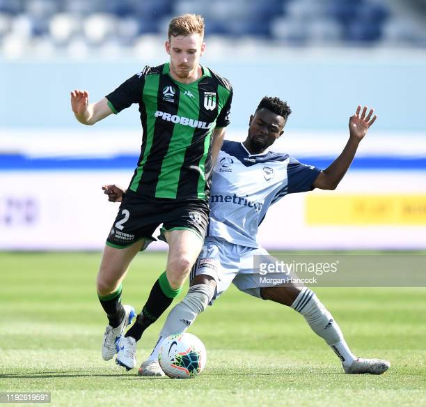 Aaron Calver of Western United and and Elvis Kamsoba of the Victory compete for the ball during the round nine A-League match between Western United...