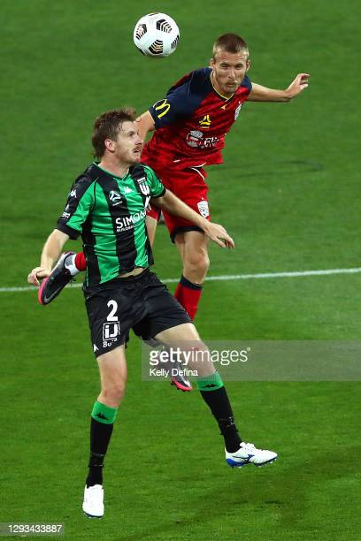 Aaron Calver of Western United and Ben Halloran of Adelaide United compete for the ball during the A-League match between Western United FC and...