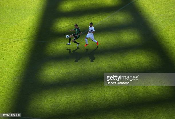 Aaron Calver of Western United and Bruno Fornaroli of Perth Glory compete for the ball during the A-League match between Western United and the Perth...