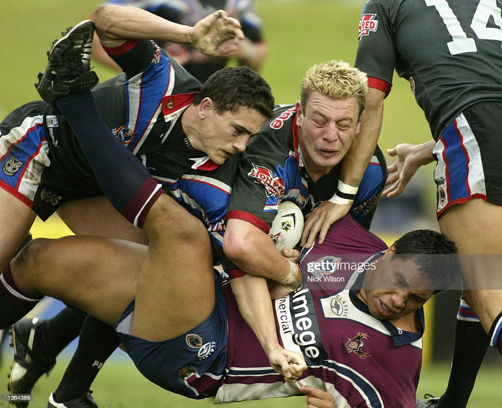 Aaron Cannings #15 of the Eagles is tackled by the Warriors defence during the round 25 NRL match between the Northern Eagles and the New Zealand Warriors played at Brookvale Oval, Sydney, Australia on September 1st 2002. (Photo by Nick Wilson/Getty Images).