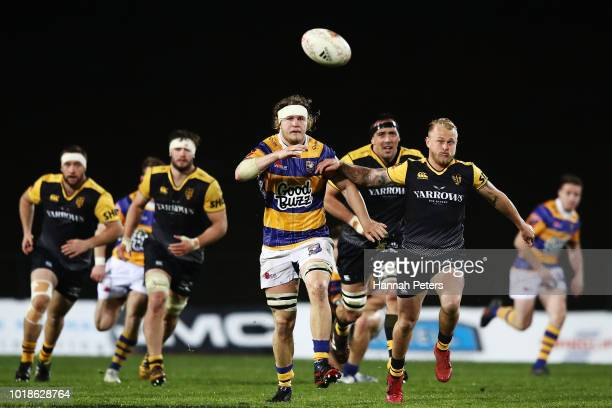Aaron Carroll of Bay of Plenty kicks the ball through as Warwick Lahmert of Taranaki chases down during the round one Mitre 10 Cup match between Bay...