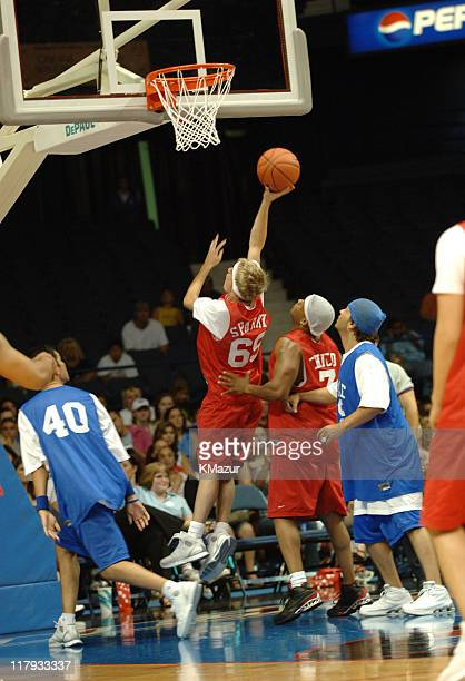 Aaron Carter and Chico Benymon during *NSYNC's Challenge for the Children VII - Celebrity Basketball Game at Allstate Arena in Chicago, Illinois,...