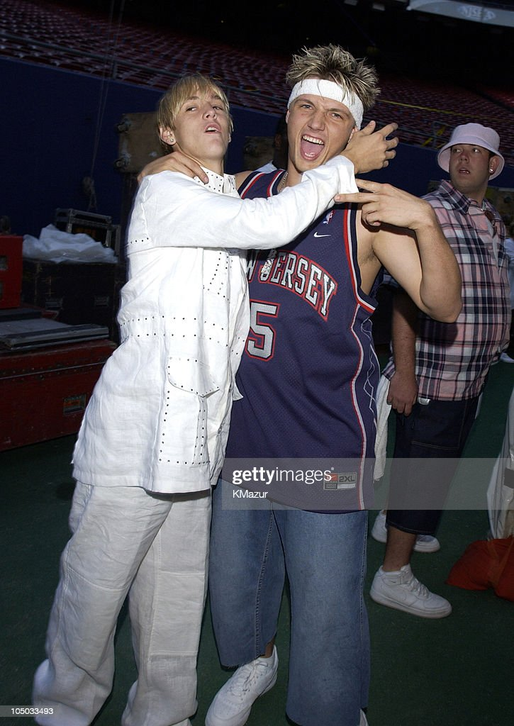 Aaron Carter and Nick Carter during Z100's Zootopia 2002 - Backstage with the New Jersey Nets & New York Yankees at Giants Stadium in East Rutherford, New Jersey, United States.