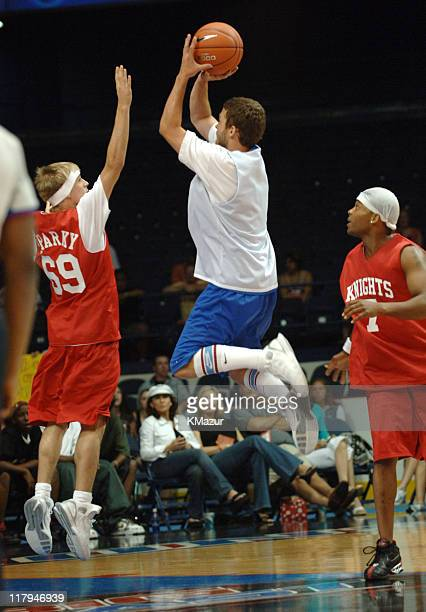 Aaron Carter, Justin Timberlake and Chico Benymon during *NSYNC's Challenge for the Children VII - Celebrity Basketball Game at Allstate Arena in...