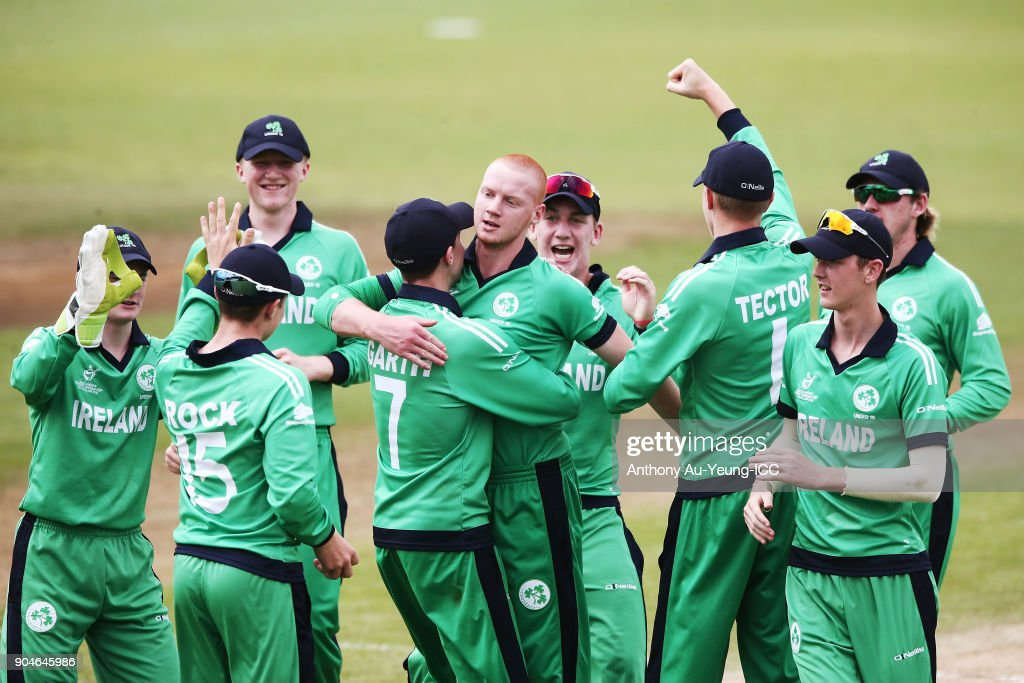 Aaron Cawley of Ireland celebrates with teammates for the wicket of Dhananjaya Lakshan of Sri Lanka during the ICC U19 Cricket World Cup match between Sri Lanka and Ireland at Cobham Oval on January 14, 2018 in Whangarei, New Zealand.