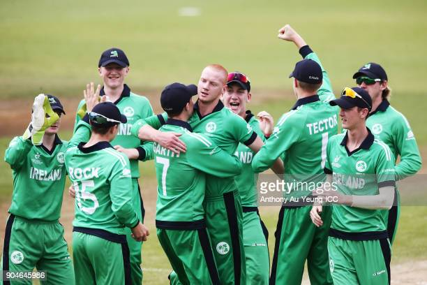 Aaron Cawley of Ireland celebrates with teammates for the wicket of Dhananjaya Lakshan of Sri Lanka during the ICC U19 Cricket World Cup match...