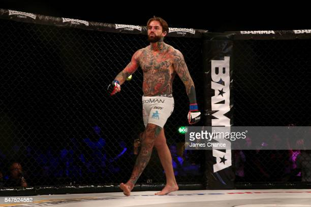 Aaron Chalmers of England celebrates victory after his Welterweight fight against Alex Thompson of England during BAMMA 31 at SSE Arena Wembley on...