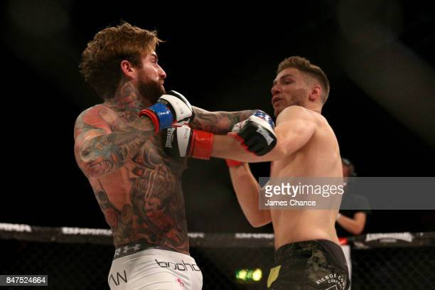Aaron Chalmers of England in action against Alex Thompson of England in their Welterweight fight during BAMMA 31 at SSE Arena Wembley on September 15...