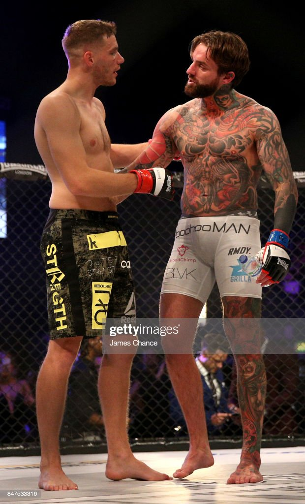 Aaron Chalmers of England in action and Alex Thompson of England embrace after their Welterweight fight during BAMMA 31 at SSE Arena Wembley on September 15, 2017 in London, England.