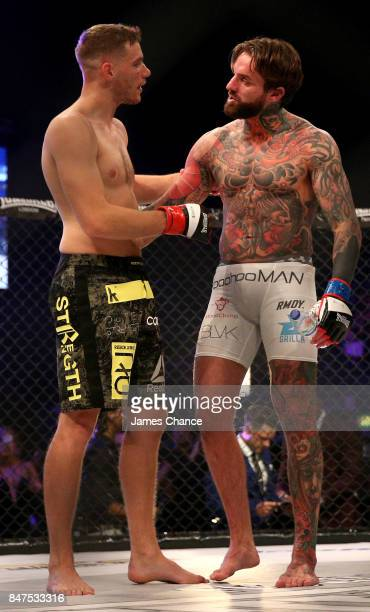 Aaron Chalmers of England in action and Alex Thompson of England embrace after their Welterweight fight during BAMMA 31 at SSE Arena Wembley on...