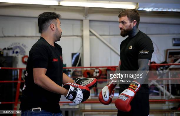 Aaron Chalmers speaks to Paulie Malignaggi during the Aaron Chalmers and Paulie Malignaggi Training Session at the Peacock Gym on November 01 2018 in...