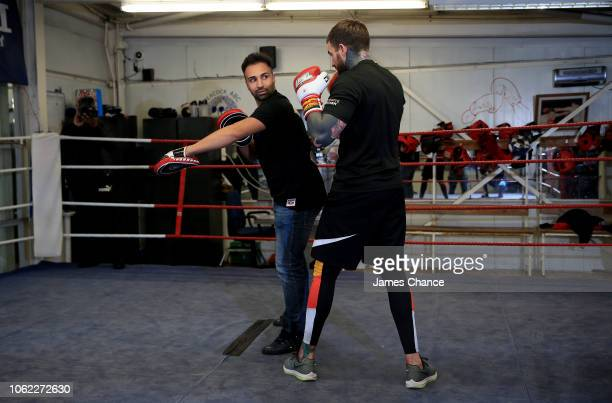 Aaron Chalmers trains with Paulie Malignaggi during the Aaron Chalmers and Paulie Malignaggi Training Session at the Peacock Gym on November 01 2018...