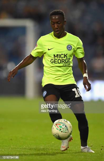 Aaron Chapman runs with the ball during the Carabao Cup First Round match between Queens Park Rangers and Peterborough United at Loftus Road on...