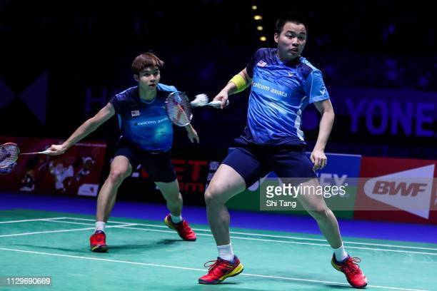 Aaron Chia and Soh Wooi Yik of Malaysia compete in the Men's Double final match against Mohammad Ahsan and Hendra Setiawan of Indonesia during day...