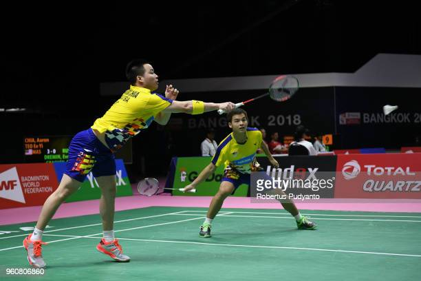 Aaron Chia and Teo Ee Yi of Malaysia compete against Evgenij Dremin and Denis Grachev of Russia during Preliminary Round on day two of the BWF Thomas...