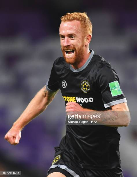 Aaron Clapham of Team Wellington celebrates after scoring his team's second goal during the FIFA Club World Cup first round play-off match between Al...