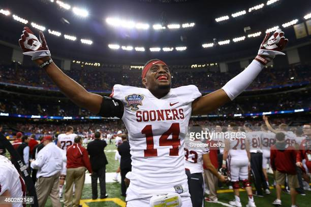 Aaron Colbin of the Oklahoma Sooners celebrates after defeating the Alabama Crimson Tide 45-31 during the Allstate Sugar Bowl at the Mercedes-Benz...