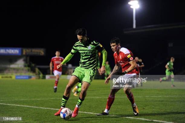 Aaron Collins of Forest Green Rovers turns with the ball under pressure from Tom Broadbent of Swindon Town during the EFL Trophy match between Forest...