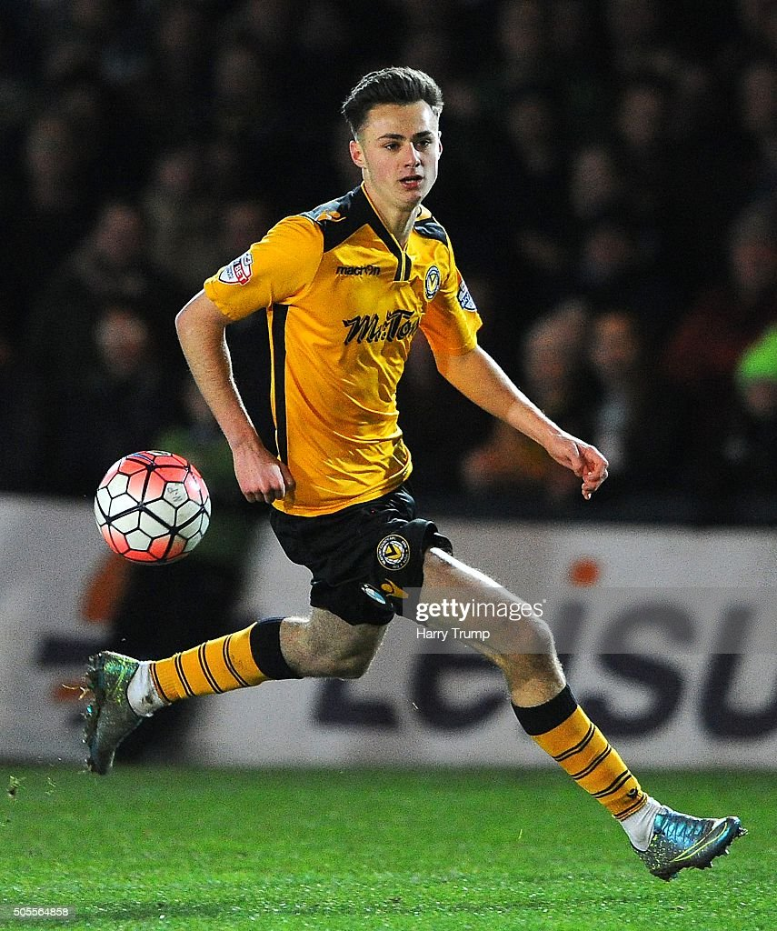 Aaron Collins of Newport County during the Emirates FA Cup Third Round match between Newport County and Blackburn Rovers at Rodney Parade on January 18, 2016 in Newport, Wales.