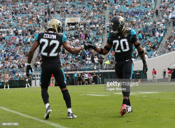 Aaron Colvin and Jalen Ramsey of the Jacksonville Jaguars celebrate a play on the field in the first half of their game against the Indianapolis...