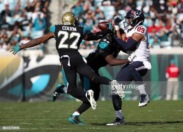 Aaron Colvin and Myles Jack of the Jacksonville Jaguars defend against Stephen Anderson of the Houston Texans during the first half of their game at...