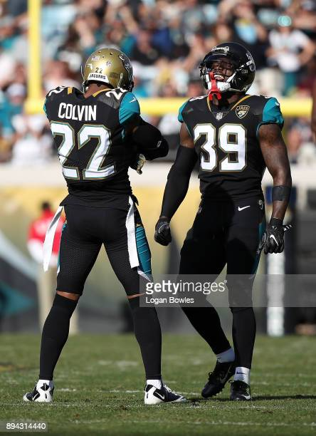 Aaron Colvin and Tashaun Gipson of the Jacksonville Jaguars celebrate a play on the field during the first half of their game against the Houston...