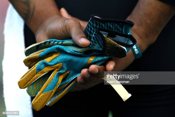 Aaron Colvin of the Jacksonville Jaguars holds his gloves before the AFC Championship Game against hte New England Patriots at Gillette Stadium on...